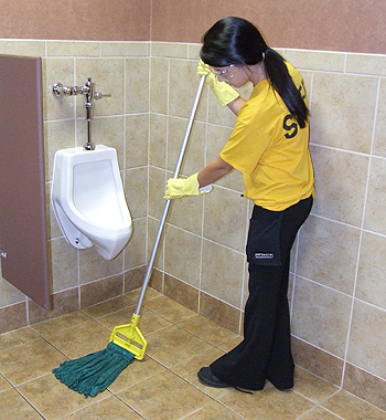 Space Management employee mopping bathroom floor