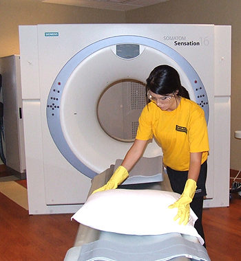 Space Management employee cleaning an MRI machine