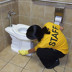 Space Management staff cleaning a toilet